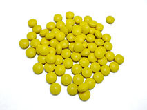 Yellow pills. On white background Stock Image