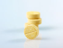 Yellow pills Stock Photos