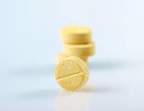 Yellow pills Stock Photos