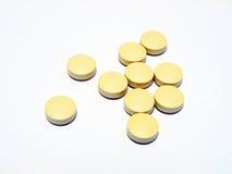 Yellow Pills. Photo of yellow pills on white background Stock Photography
