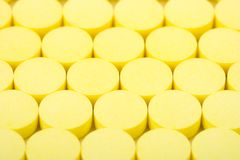 Yellow pills Royalty Free Stock Image