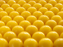 Yellow pills abstract. Abstract closeup of rows of yellow vitamin pills Royalty Free Stock Photography