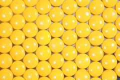 Yellow pills background Stock Photo