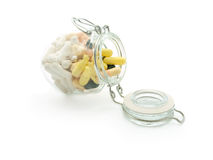 Yellow pills in blister jar Royalty Free Stock Image