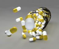 Yellow pills and bottle Stock Photography