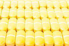 Yellow pills closeup Stock Photography