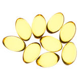 Yellow pills isolated background Stock Image