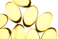 Yellow pills isolated background. Yellow pills isolated macro background Royalty Free Stock Image