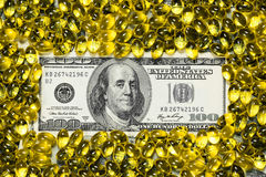 Yellow pills and one hundred dollars banknote Royalty Free Stock Photos