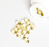 Yellow pills and a package of pills isolated Stock Photography