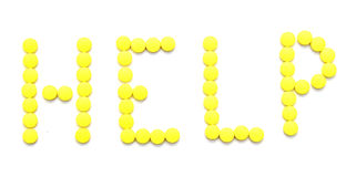 Yellow pills spelling the word help royalty free stock image