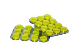 Yellow pills on white background Royalty Free Stock Photos