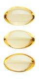 Yellow pills on white Royalty Free Stock Photo