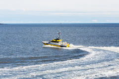 Yellow Pilot Boat Curving Through Water Royalty Free Stock Images