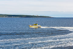 Yellow Pilot Boat Cutting Across Bay Royalty Free Stock Images