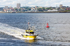 Yellow Pilot Boat and Red Channel Marker Stock Photo