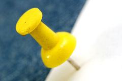 Yellow pin Stock Photography