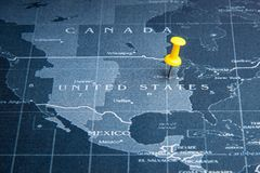 Yellow pin on the world map pin to United States of america coun. Tries.Business world wide system concept stock photos