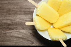 Yellow Pineapple Ice Lollies on Wood from Above Royalty Free Stock Images