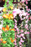 Yellow and Pink Artificial flowers colorful. Royalty Free Stock Photo