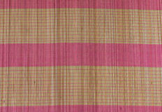 yellow and pink bamboo mat background Royalty Free Stock Photo