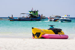 Yellow-pink banana boat on the beach Royalty Free Stock Photo