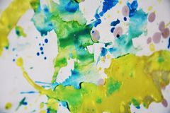 Yellow pink blue colorful background, paint watercolor and waxy spots royalty free stock image