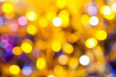 Yellow pink blurred shimmering Christmas lights. Abstract blurred background - yellow and pink shimmering Christmas lights bokeh of electric garlands on Xmas Stock Images