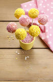 Yellow and pink cake pops Stock Images