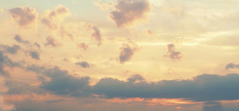 Yellow pink clouds sky background Stock Images