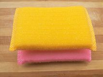 Yellow and pink colored scrub pads Royalty Free Stock Photos