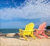 Yellow and pink colorful  lounge chairs on a beach in Florida Royalty Free Stock Photography