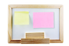 Yellow and pink memo not on whiteboard. Whiteboard with yellow and pink post it note on white background Stock Image