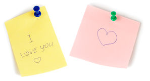 Yellow and pink note papers with push and heart isolated Royalty Free Stock Photos