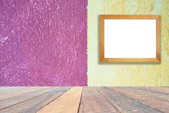 Yellow and pink paint cement wall , vintage wall Textured background .and empty wood desk and Wooden frame . Blank space for text and images stock photography
