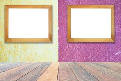 Yellow and pink paint cement wall , vintage wall Textured background .and empty wood desk and Wooden frame . Blank space for text and images royalty free stock photos