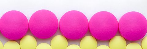 Yellow and pink pills on a white background royalty free stock image