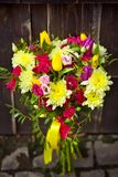 Yellow and pink wedding bouquet on a dark background stock images