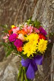 Yellow and pink wedding bouquet on a rock background royalty free stock images