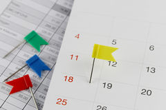 Yellow Pins to Wildcats on the calendar beside the number of eig Royalty Free Stock Images