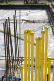 Yellow pipe at construction site stock photos