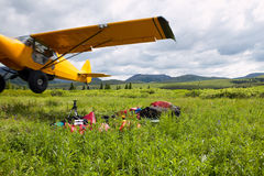 Yellow piper cub bush plane taking off Royalty Free Stock Photography