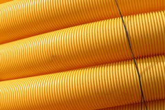 Yellow pipes. Several yellow empty pipes royalty free stock photo