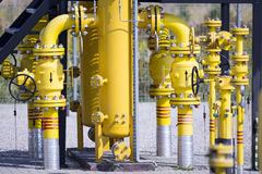 Yellow pipes nad valves Royalty Free Stock Photos
