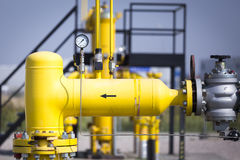 Yellow pipes nad valves Royalty Free Stock Photo