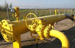 Yellow pipes and valve Royalty Free Stock Photography