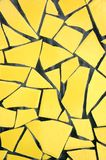 Yellow Pique Assiette Backgrou. A yellow broken tile mosaic background pattern Royalty Free Stock Images