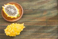 Yellow Pitaya or organic dragon fruit from tropical - Wooden background. The yellow pitaya is grown in Colombia and is found in the market from January to March Royalty Free Stock Image