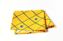 Yellow placemat. Small yellow place mat with flower pattern Royalty Free Stock Photography