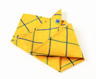 Yellow placemat. Small yellow place mat with flower pattern Stock Photos